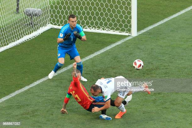 Sergey Ignashevich of Russia scores an own goal to bring the score to 10 as he drags Sergio Ramos of Spain down in the box during the 2018 FIFA World...