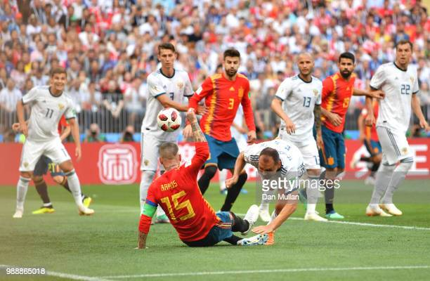 Sergey Ignashevich of Russia scores an own goal to put Spain in front 10 during the 2018 FIFA World Cup Russia Round of 16 match between Spain and...