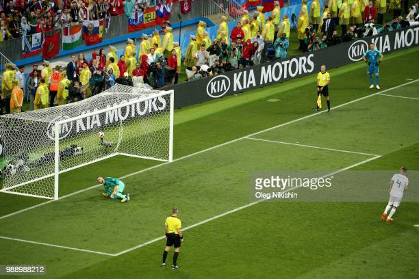 Sergey Ignashevich of Russia scores his team's second penalty in the penalty shoot out during the 2018 FIFA World Cup Russia Round of 16 match...