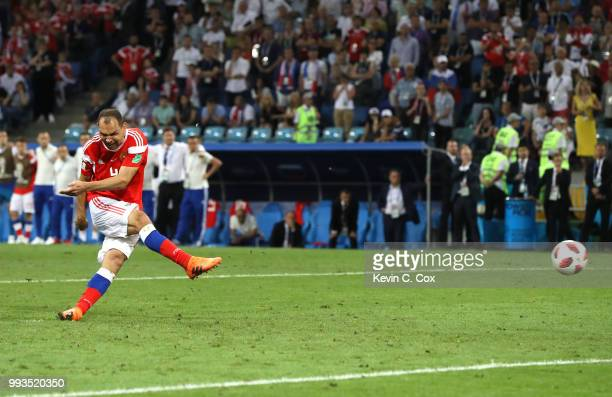 Sergey Ignashevich scores his team's fourth penalty in the penalty shoot out during the 2018 FIFA World Cup Russia Quarter Final match between Russia...
