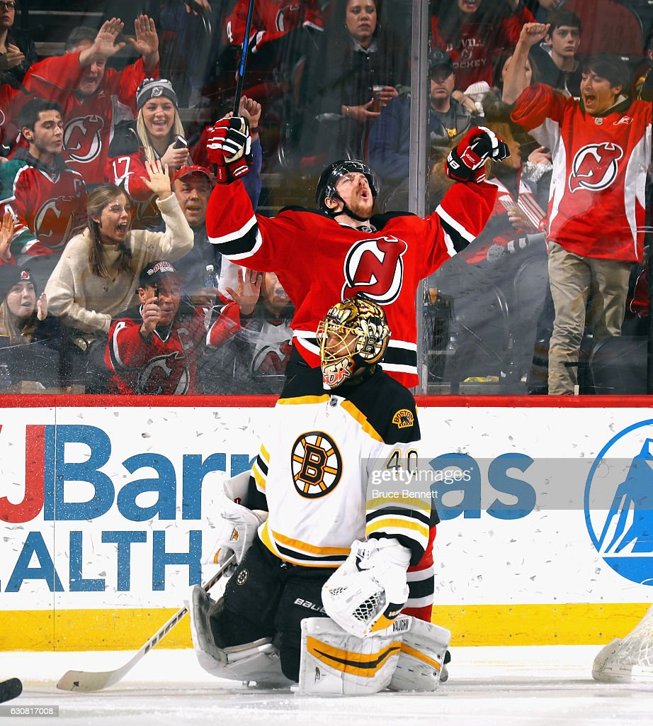 Sergey Kalinin #51 of the New Jersey Devils celebrates his goal at 1:54 of the third period against Tuukka Rask #40 of the Boston Bruins at the Prudential Center on January 2, 2017 in Newark, New Jersey. The Devils shutout the Bruins 3-0.