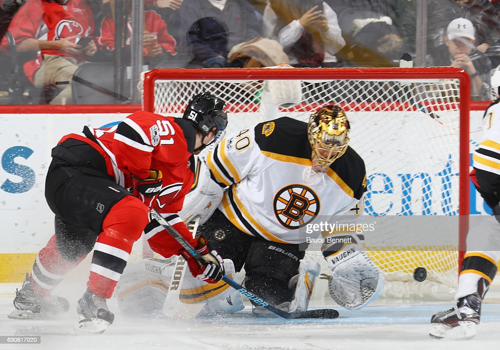 Sergey Kalinin #51 of the New Jersey Devils scores at 1:54 of the third period against Tuukka Rask #40 of the Boston Bruins at the Prudential Center on January 2, 2017 in Newark, New Jersey. The Devils shutout the Bruins 3-0.