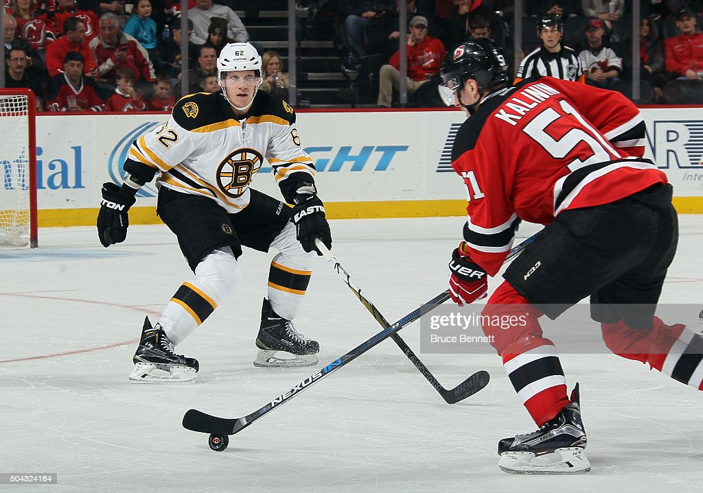 Sergey Kalinin #51 of the New Jersey Devils skates in on Zach Trotman #62 of the Boston Bruins at the Prudential Center on January 8, 2016 in Newark, New Jersey. The Bruins defeated the Devils 4-1.