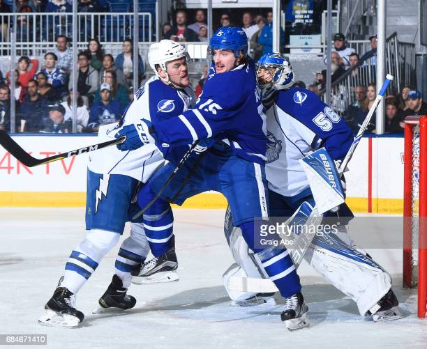 Sergey Kalinin of the Toronto Marlies battles in front of the net with Jake Dotchin and goalie Mike McKenna of the Syracuse Crunch during game 6...