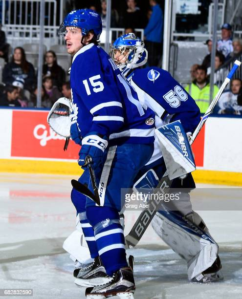 Sergey Kalinin of the Toronto Marlies puts a screen on goalie Mike McKenna of the Syracuse Crunch during game 4 action in the Division Final of the...