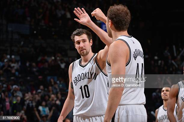 Sergey Karasev and Bojan Bogdanovic of the Brooklyn Nets give each other high fives after the win against the Indiana Pacers on March 26 2016 at...