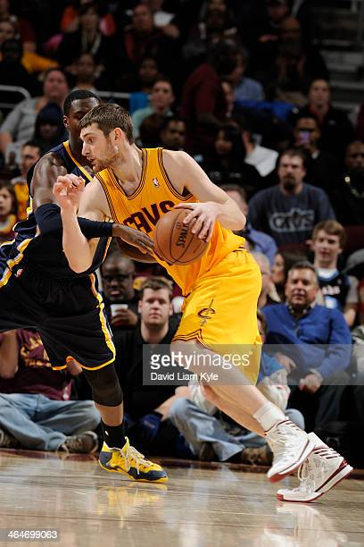 Sergey Karasev of the Cleveland Cavaliers drives to the basket against the Indiana Pacers at The Quicken Loans Arena on January 5 2014 in Cleveland...