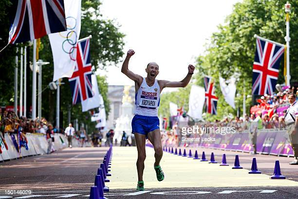 Sergey Kirdyapkin of Russia crosses the line to win gold during the Men's 50km Walk on Day 15 of the London 2012 Olympic Games at The Mall on August...