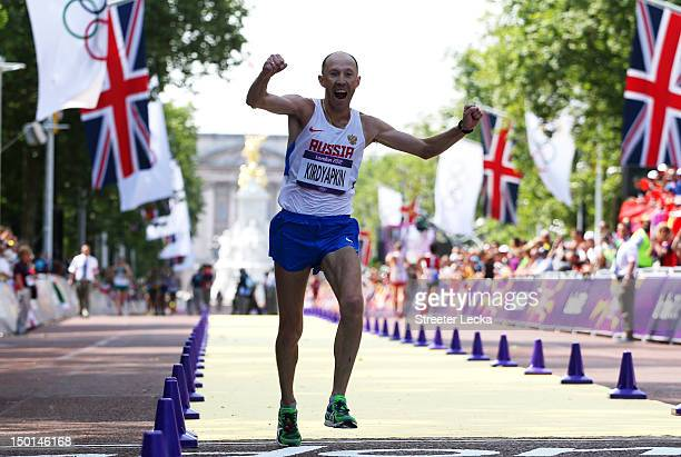 Sergey Kirdyapkin of Russia crosses the line to win gold during the Men's 50km Walk on Day 15 of the London 2012 Olympic Games on the streets of...