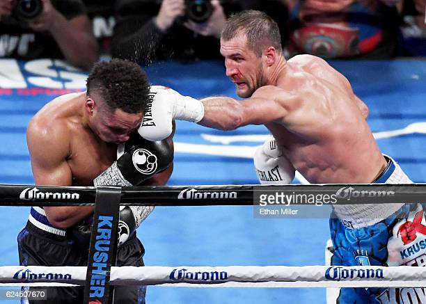 Sergey Kovalev hits Andre Ward with a left in the 11th round of their light heavyweight championship bout at TMobile Arena on November 19 2016 in Las...