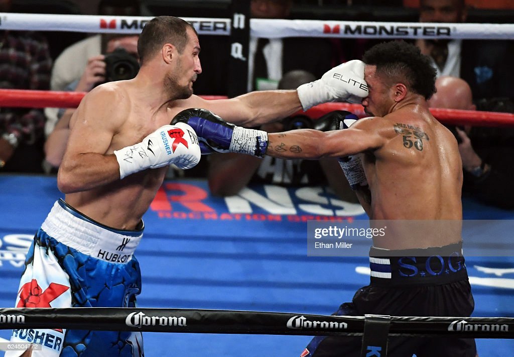 Sergey Kovalev (L) hits Andre Ward with a left in the second round of their light heavyweight championship bout at T-Mobile Arena on November 19, 2016 in Las Vegas, Nevada. Ward took Kovalev's WBA, IBF and WBO titles with a unanimous-decision victory.