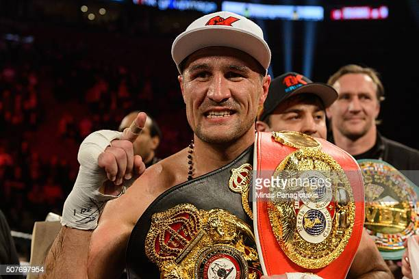 Sergey Kovalev of Russia posses with his belts after defeating Jean Pascal of Canada by way of TKO at the end of the seventh round during the WBO WBA...