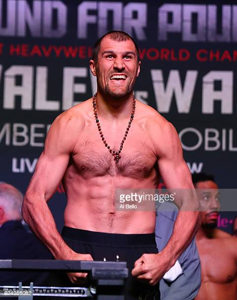 Sergey Kovalev poses on the scale during the official weigh-in on November 18, 2016 at MGM Grand Garden Arena in Las Vegas, Nevada. Kovalev will face...
