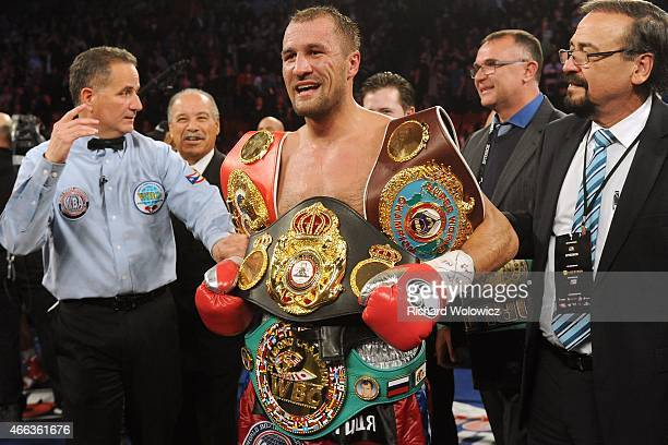 Sergey Kovalev stands with all the belts after defeating Jean Pascal during their Unified light heavyweight championship bout at the Bell Centre on...