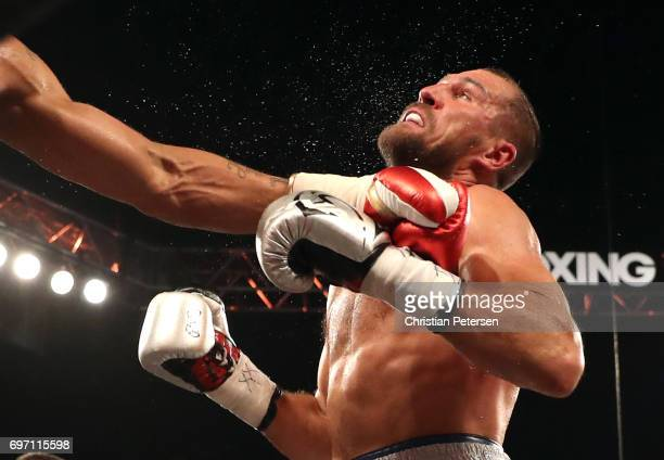 Sergey Kovalev takes a hit from Andre Ward during their light heavyweight championship bout at the Mandalay Bay Events Center on June 17 2017 in Las...
