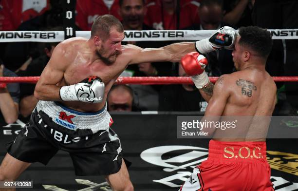 Sergey Kovalev throws a left at Andre Ward in the fourth round of their light heavyweight championship bout at the Mandalay Bay Events Center on June...
