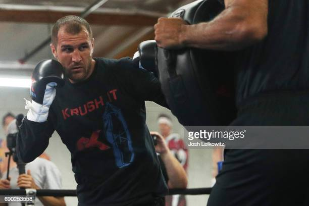 "Sergey ""Krusher"" Kovalev works out with trainer John David Jackson at the Boxing Laboratory on May 30, 2017 in Oxnard, California."