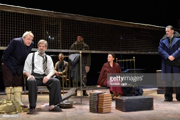 Sergey Kuryshev as Victor Shtrum and Elena Solomonova as Lyudmila with artists of the company in the Maly Drama Theatre's production of Vasily...