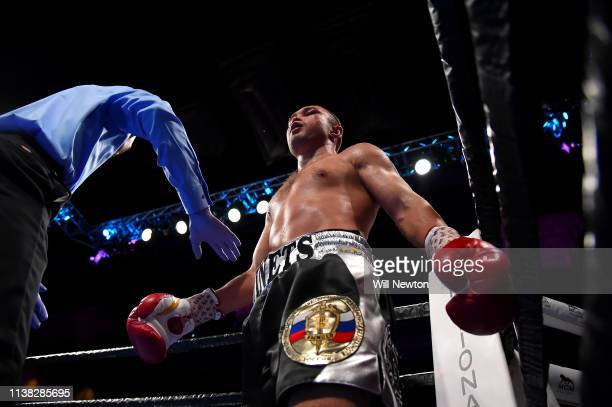 Sergey Lipinets is held back after knocking down Lamont Peterson during their welterweight fight at The Theater at MGM National Harbor on March 24...