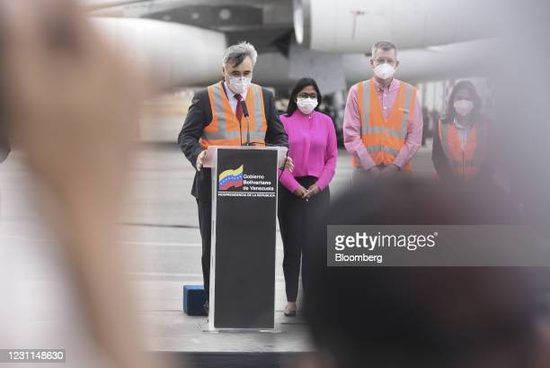 Sergey Melik-Bagdasarov, Russia's ambassador to Venezuela, left, speaks as Delcy Rodriguez, Venezuela's vice president, during a press conference as...