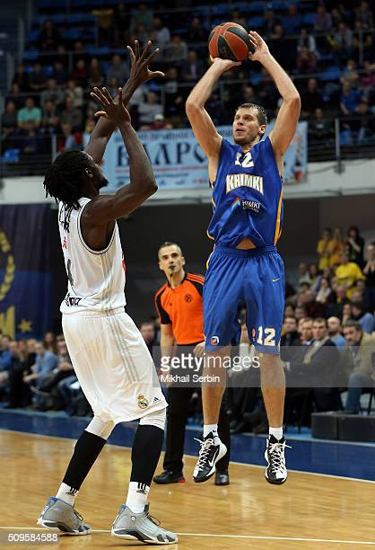 Sergey Monia #12 of Khimki Moscow Region competes with Jeffery Taylor #44 of Real Madrid in action during the Turkish Airlines Euroleague Basketball...