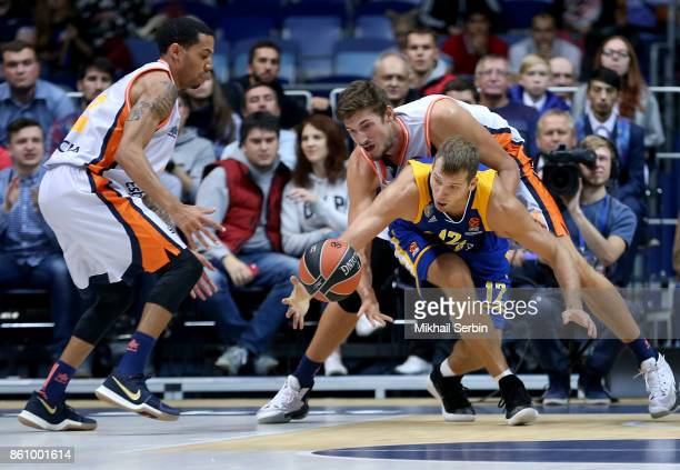 Sergey Monia #12 of Khimki Moscow Region competes with Tibor Pleiss #21 of Valencia Basket in action during the 2017/2018 Turkish Airlines EuroLeague...