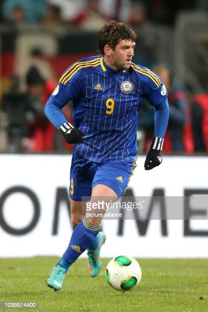 Sergey Ostapenko of Kazakhstan plays the ball during the FIFA World Cup 2014 qualification group C soccer match between Germany and Kazakhstan at...