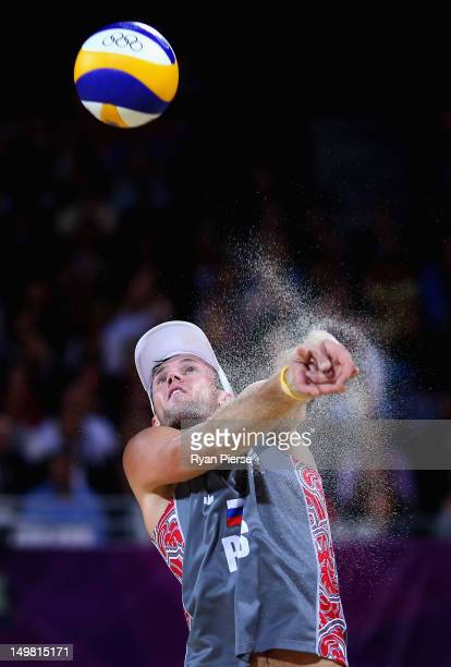 Sergey Prokopyev of Russia sets the ball during the Men's Beach Volleyball Round of 16 match between United States and Russia on Day 8 of the London...