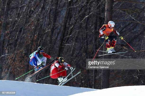 Sergey Ridzik of Olympic athletes of Russia Dave Duncan of Canada and Jean Frederic Chapuis of France competes in the Freestyle Skiing Men's Ski...
