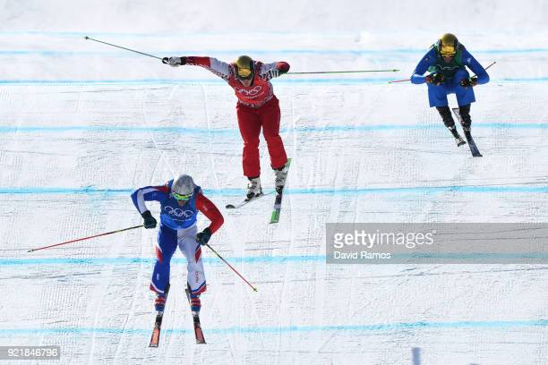 Sergey Ridzik of Olympic athletes of Russia Francois Place of France and Siegmar Klotz of Italy competes in the Freestyle Skiing Men's Ski Cross 1/8...
