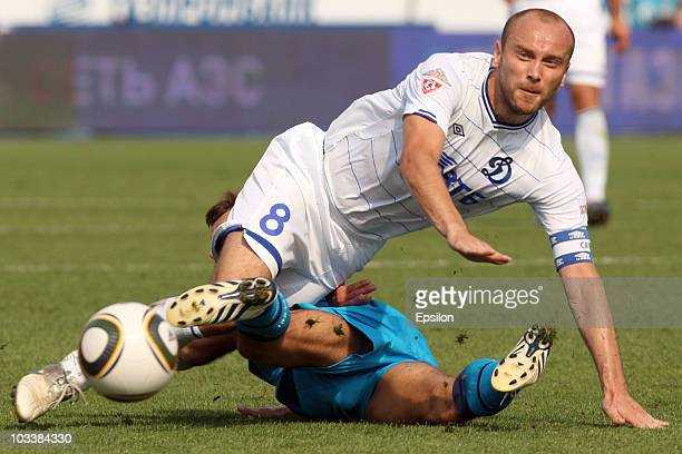 Sergey Semak of FC Zenit St Petersburg battles for the ball with Dmitry Khokhlov of FC Dinamo Moscow during the Russian Football League Championship...