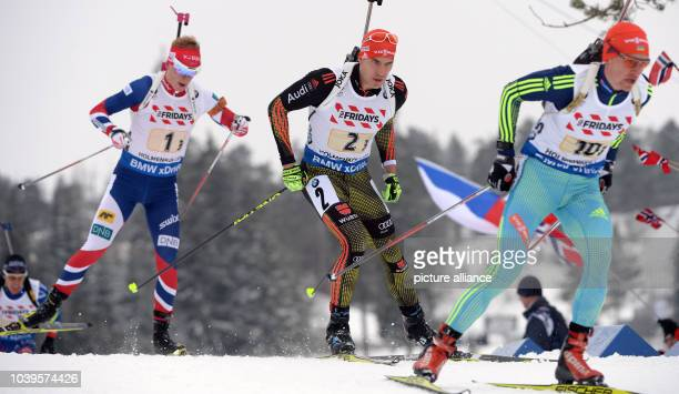 Sergey Semenov of Ukraine Arnd Peiffer of Germany and Johannes Thingnes Boe of Norway during the mixed relay competition at the Biathlon World...