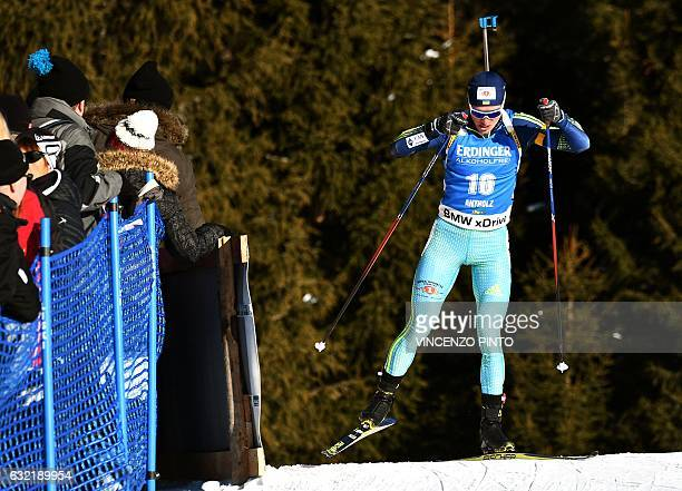 Sergey Semenov of Ukraine competes during the Biathlon World Cup Men's 20km individual race in Anterselva on January 20 2017 Anton Shipulin of Russia...