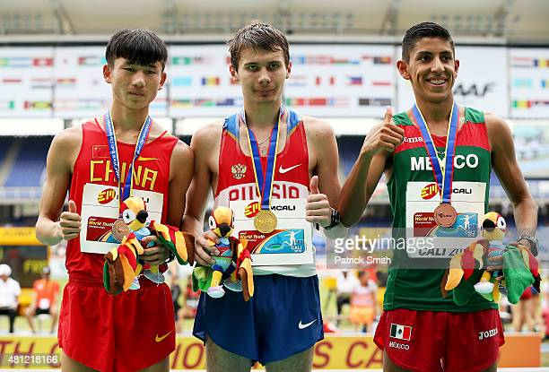 Sergey Shirobokov of Russia gold medal Jun Zhang of China silver medal and Federico Gonzalez of Mexico bronze medal celebrate on the podium after the...