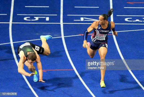 Sergey Shubenkov of Authorised Neutral Athlete falls to the ground after crossing the finish line in competition with Pascal Martinot-Lagarde of...