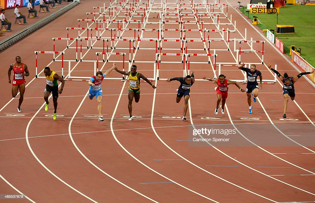 Sergey Shubenkov of Russia (3rd L) crosses the finish line to win gold in the Men's 110 metres hurdles final ahead of Hansle Parchment of Jamaica (2nd L) during day seven of the 15th IAAF World Athletics Championships Beijing 2015 at Beijing National Stadium on August 28, 2015 in Beijing, China.