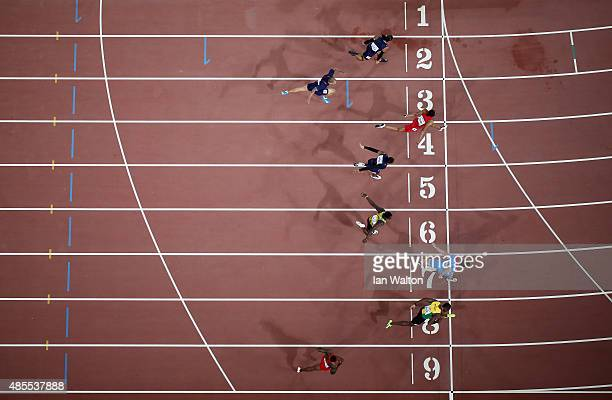 Sergey Shubenkov of Russia crosses the finish line to win gold in the Men's 110 metres hurdles final ahead of Hansle Parchment of Jamaica during day...