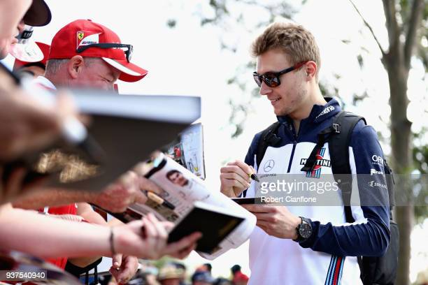 Sergey Sirotkin of Russia and Williams arrives at the circuit and signs autographs for fans before the Australian Formula One Grand Prix at Albert...