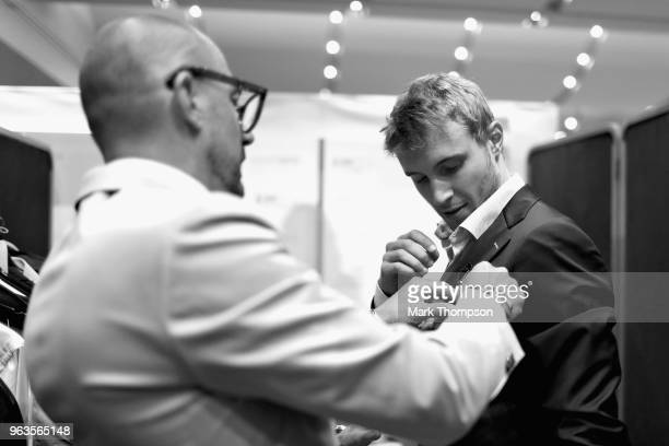 Sergey Sirotkin of Russia and Williams prepares backstage at the Amber Lounge Fashion show during previews ahead of the Monaco Formula One Grand Prix...
