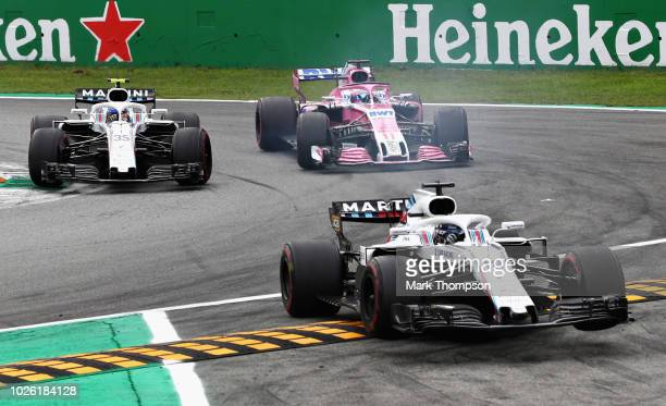 Sergey Sirotkin of Russia driving the Williams Martini Racing FW41 Mercedes Sergio Perez of Mexico driving the Sahara Force India F1 Team VJM11...