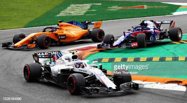 Sergey Sirotkin of Russia driving the Williams Martini Racing FW41 Mercedes Fernando Alonso of Spain driving the McLaren F1 Team MCL33 Renault and...