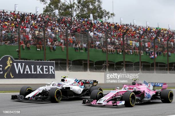 Sergey Sirotkin of Russia driving the Williams Martini Racing FW41 Mercedes and Esteban Ocon of France driving the Sahara Force India F1 Team VJM11...