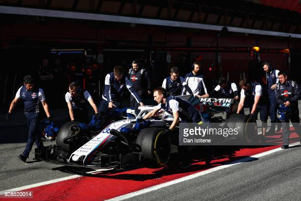Sergey Sirotkin of Russia driving the Williams Martini Racing FW41 Mercedes is recovered from the pit lane during day two of F1 Winter Testing at...