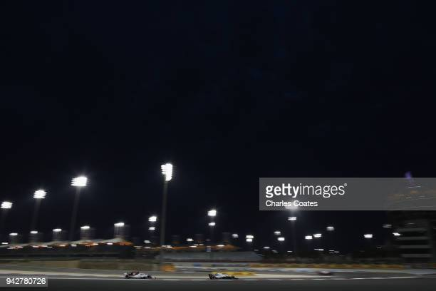 Sergey Sirotkin of Russia driving the Williams Martini Racing FW41 Mercedes and Marcus Ericsson of Sweden driving the Alfa Romeo Sauber F1 Team C37...