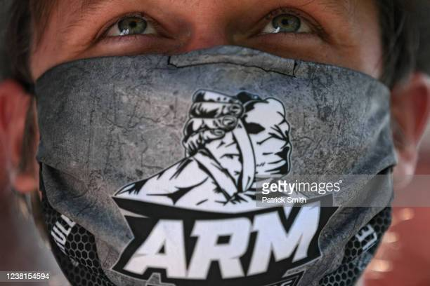 Sergey Svetlikov wears a mask as he looks on during the Frederick County Maryland Arm Wrestling Team's practice at the home of Sergey Svetlikov on...