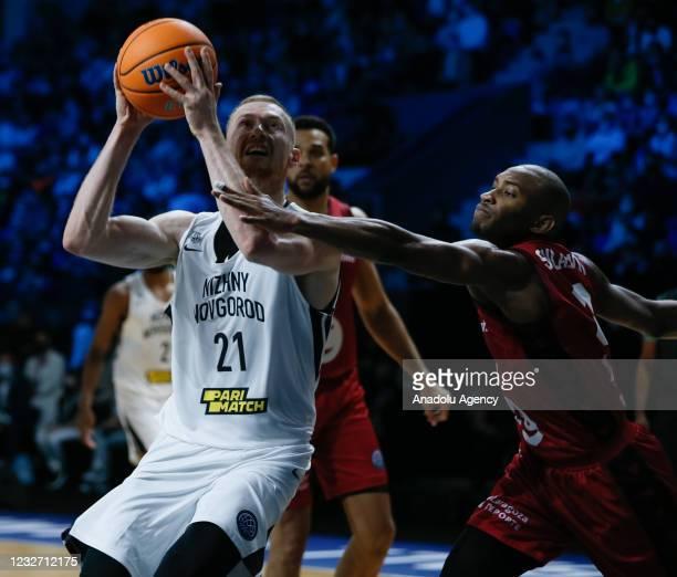 Sergey Toropov of Nizhny Novgorod in action against Rasheed Sulaimon of Casademont Zaragoza during FIBA Champions League Final 8 basketball match...