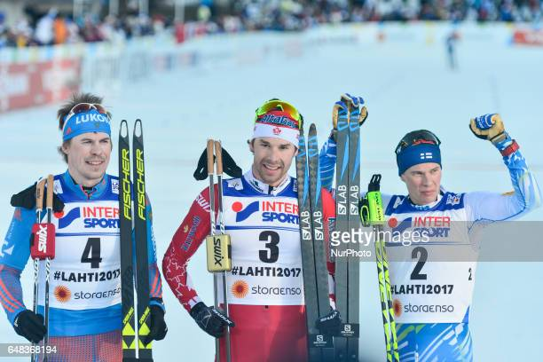Sergey Ustiugov from Russia Alex Harvey from Canada and Matti Heikkinen from Finland the podium of Men crosscountry 50 km Mass Start Free at FIS...