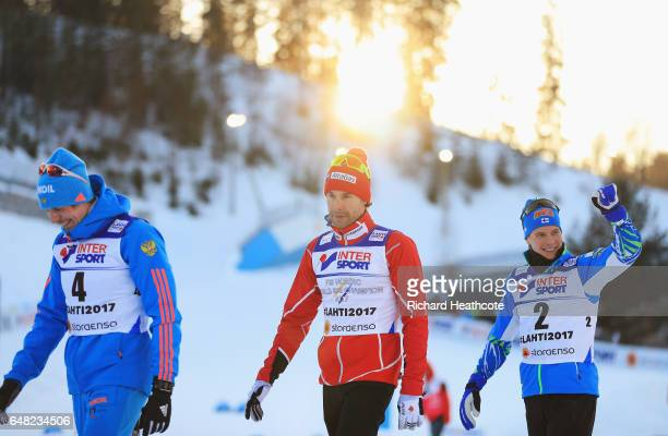 Sergey Ustiugov of Russia Alex Harvey of Canada and Matti Heikkinen of Finland are seen after the Men's Cross Country Mass Start during the FIS...