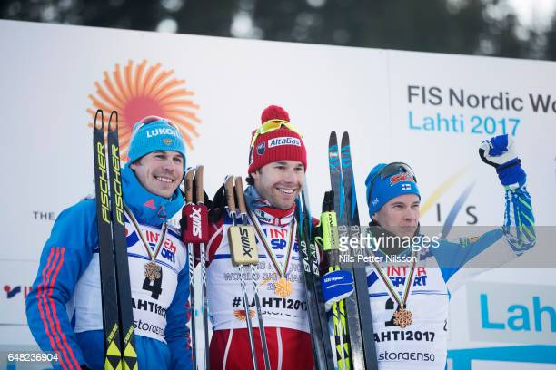 Sergey Ustiugov of Russia Alex Harvey of Canada and Matti Heikkinen of Finland during the men´s mass start race during the FIS Nordic World Ski...