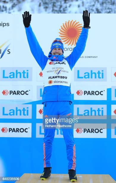 Sergey Ustiugov of Russia celebrates winning the gold medal during the flower ceromeny after the Men's Cross Country Skiathlon during the FIS Nordic...